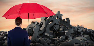 Composite image of rear view of businesswoman holding red umbrella. Rear view of businesswoman holding red umbrella against full frame shot of sky Royalty Free Stock Photo