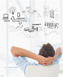 Composite image of rear view of a casual man resting with hands behind head in office Stock Image
