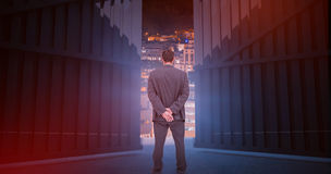 Composite image of rear view of classy businessman posing 3d Royalty Free Stock Photos
