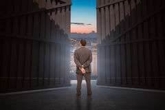 Composite image of rear view of classy businessman posing 3d. Rear view of classy businessman posing against illuminated buildings in city against sky 3d Stock Photography