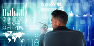 Composite image of rear view of male executive holding cigar. Rear view of male executive holding cigar against blue technology design with binary code Royalty Free Stock Images