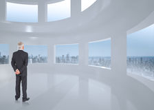 Composite image of rear view of mature businessman posing Royalty Free Stock Photos