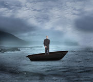 Composite image of rear view of mature businessman posing in a sailboat Royalty Free Stock Photos
