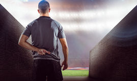 Composite image of rear view of rugby player with fingers crossed Royalty Free Stock Photography
