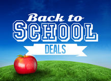 Composite image of red apple with back to school message Stock Image