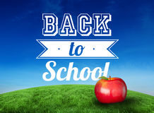 Composite image of red apple with back to school message Stock Images