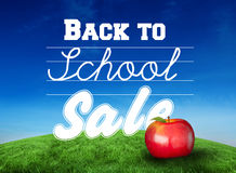 Composite image of red apple with back to school message Royalty Free Stock Images