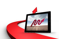 Composite image of red arrow on tablet screen Stock Images