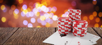 Composite image of red casino tokens with playing cards Stock Photography