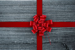 Composite image of red christmas bow and ribbon Royalty Free Stock Photo