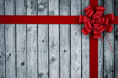 Composite image of red christmas bow and ribbon Stock Photography