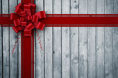 Composite image of red christmas bow and ribbon Stock Photo