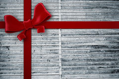 Composite image of red christmas bow and ribbon Royalty Free Stock Photos