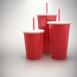 Composite image of red cups over white background. Red cups over white background against grey background Royalty Free Stock Photos