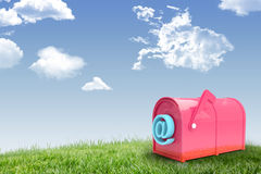 Composite image of red email post box. Red email post box against field and sky Stock Photos