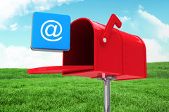 Composite image of red email postbox. Red email postbox against field and sky Stock Photos
