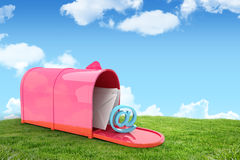 Composite image of red email postbox. Red email postbox against field and sky Royalty Free Stock Images