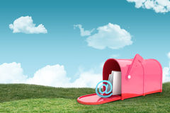 Composite image of red email postbox. Red email postbox against field and sky Stock Image