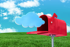 Composite image of red email postbox. Red email postbox against field and sky Royalty Free Stock Photo