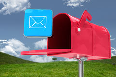 Composite image of red email postbox. Red email postbox against field and sky Royalty Free Stock Photos