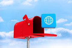 Composite image of red email postbox. Red email postbox against field and sky Stock Photography