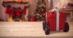 Composite image of red gift box on wheels Royalty Free Stock Photo