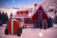 Composite image of red gift box on wheels Stock Image