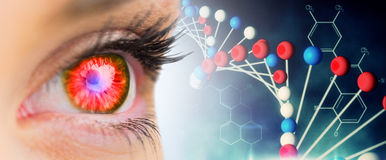 Composite image of red glowing eye looking ahead Royalty Free Stock Images