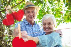 Composite image of red hanging hearts and senior couple dancing Royalty Free Stock Photos