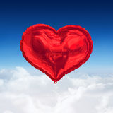 Composite image of red heart balloon Stock Photography