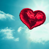Composite image of red heart balloon Royalty Free Stock Photo