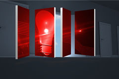 Composite image of red light bulb graphic on abstract screen Royalty Free Stock Photos