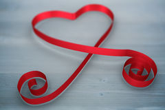 Composite image of red ribbon heart Stock Photography
