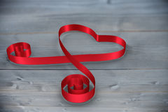Composite image of red ribbon heart Royalty Free Stock Photos
