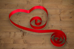 Composite image of red ribbon heart. Red ribbon heart against bleached wooden planks background Stock Photos