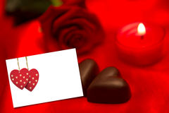 Composite image of red rose candle and chocolate hearts Stock Images