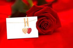 Composite image of red rose lying on surface Royalty Free Stock Image
