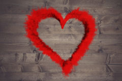 Composite image of red smoke heart. Red smoke heart against bleached wooden planks background Royalty Free Stock Photo