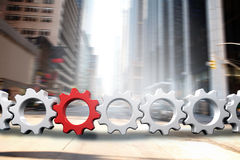 Composite image of red and white cogs and wheels. Red and white cogs and wheels against new york street Stock Image