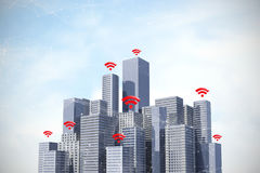 Composite image of red wifi symbol. Red wifi symbol against blue sky with clouds Royalty Free Stock Images