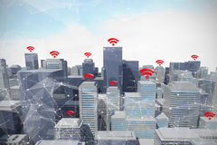 Composite image of red wifi symbol. Red wifi symbol against blue sky with clouds Royalty Free Stock Photos