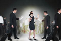Composite image of redhead businesswoman in a blindfold Stock Image