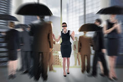 Composite image of redhead businesswoman in a blindfold Stock Photos