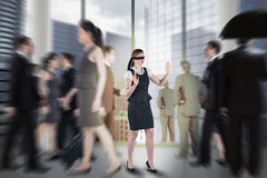 Composite image of redhead businesswoman in a blindfold Royalty Free Stock Photography