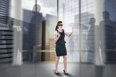 Composite image of redhead businesswoman in a blindfold Royalty Free Stock Photos