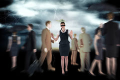Composite image of redhead businesswoman in a blindfold Royalty Free Stock Photo