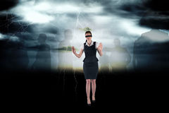 Composite image of redhead businesswoman in a blindfold Royalty Free Stock Images