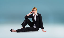 Composite image of redhead businesswoman on the phone Royalty Free Stock Photos