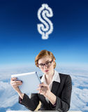 Composite image of redhead businesswoman using her tablet pc Royalty Free Stock Photography