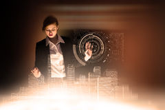 Composite image of redhead businesswoman using interactive desk Stock Photo